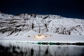 A view of the Minaret Station Alpine Lodge at night.