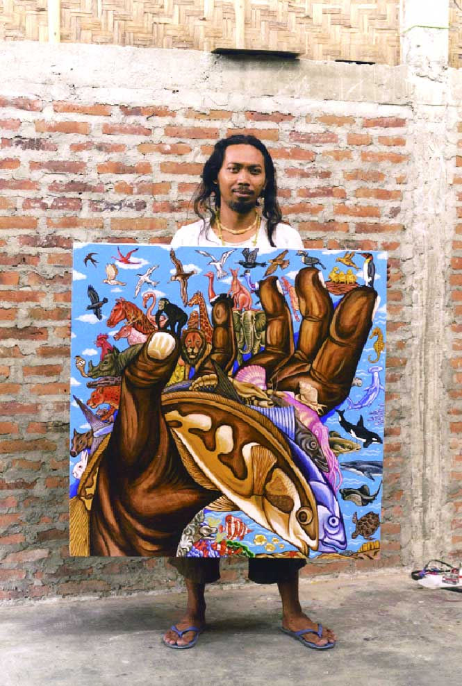 Mohammad Yusuf of the Taring Padi group with a recent painting.