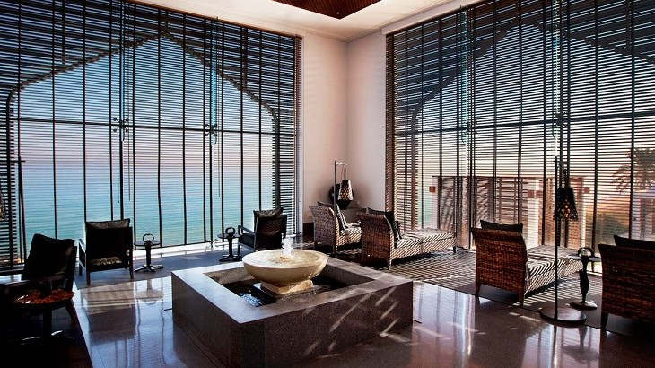 The spa relaxation room at The Chedi Muscat overlooks the coastline of Muscat.