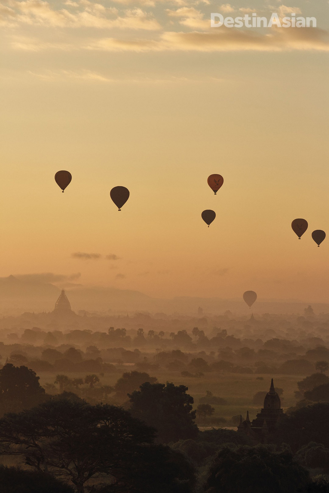 Hot-air balloons on a dawn flight over the temples and pagodas of Bagan.