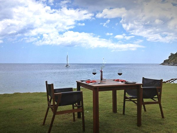 The resort can plan a beachfront dinner for guests.