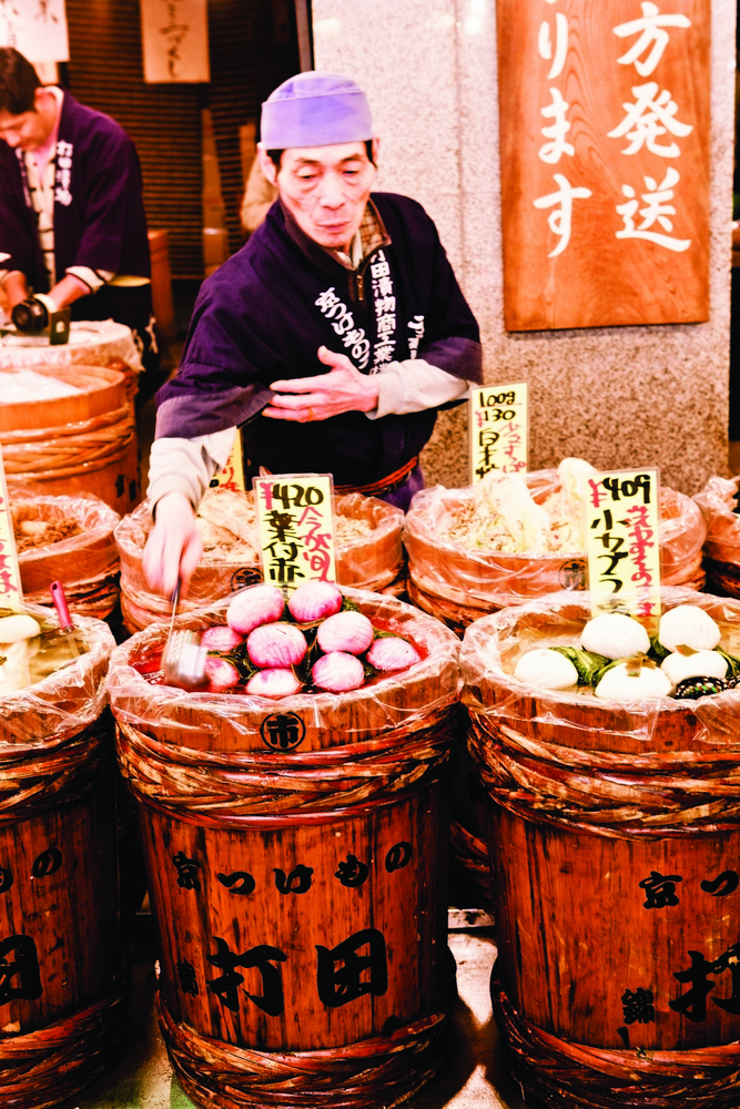 Barrels of vegetables—radishes, lotus roots, eggplants, turnips—mark the entrance to Uchida.