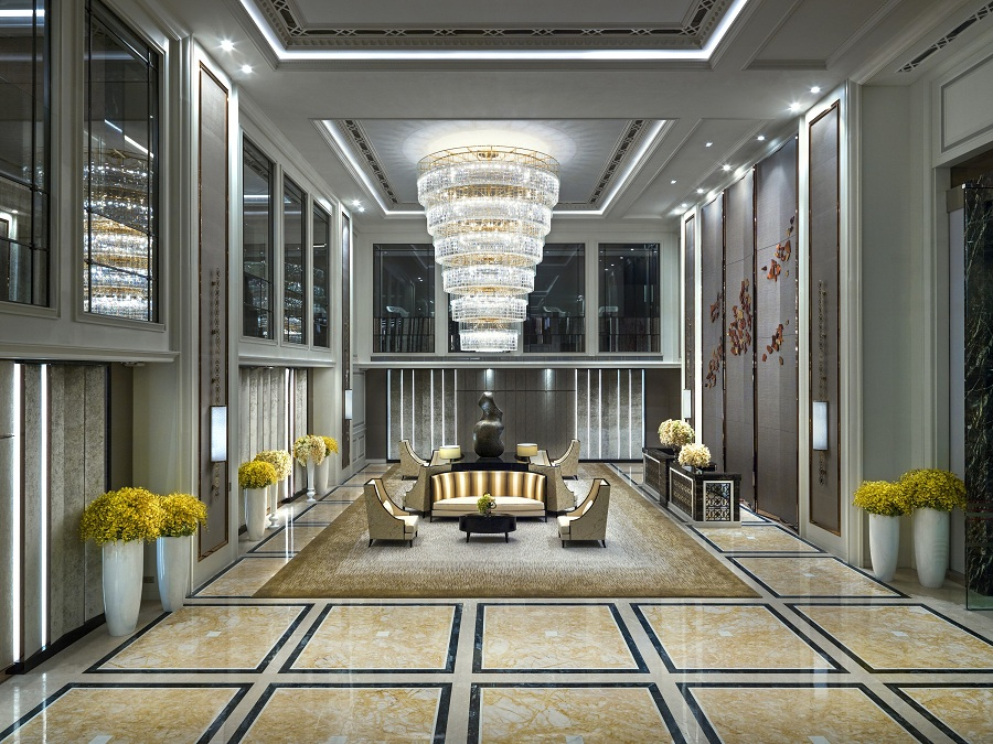 One of the city's largest hotel chandeliers hangs in the lavish lobby.