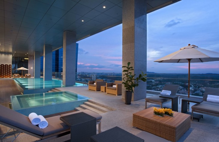 A modern pool area at Singapore's Oasia Club, under the Far East Hospitality group.