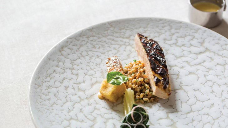 Odette signatures include braised Challans guinea fowl with celery risotto and breaded foie gras.