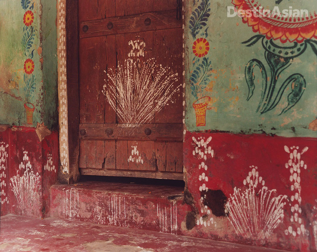 A rice painting dedicated to the goddess Lakshmi adorns the entrance to a house in Puri. Photo: Kate Eshelby