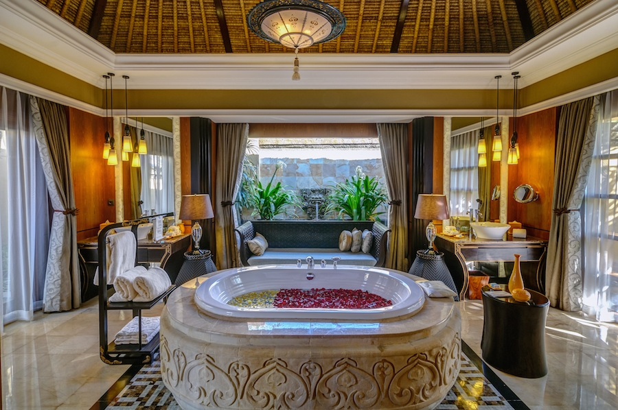 A hand-carved, Roman-style bath sits as the centerpiece in the marble bathrooms.