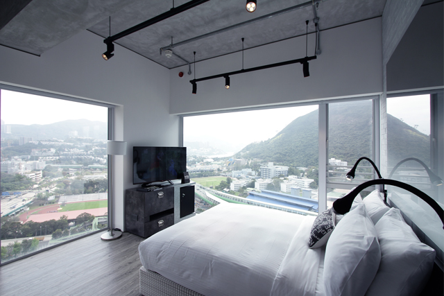Floor-to-ceiling windows reveal beautiful views of Hong Kong's South Coast area.
