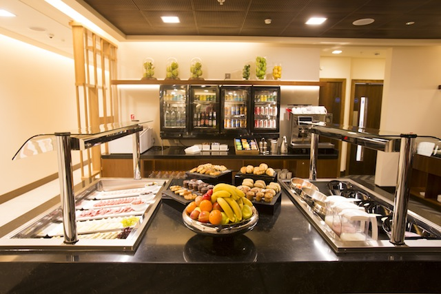 Business-class guests can dine from a self-service buffet.