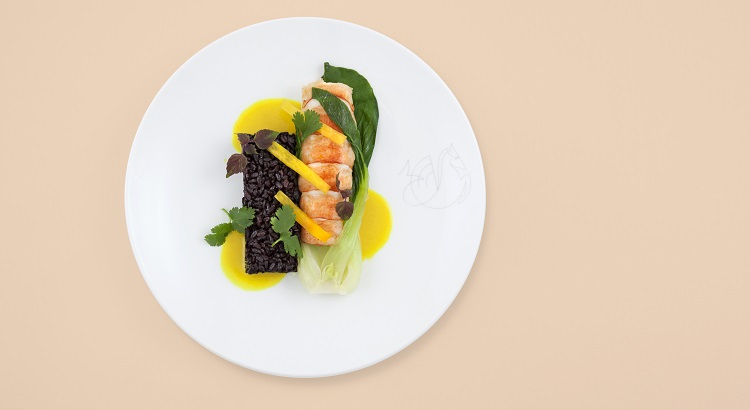 Lobster with curried coconut sauce, black rice, and bok choy.