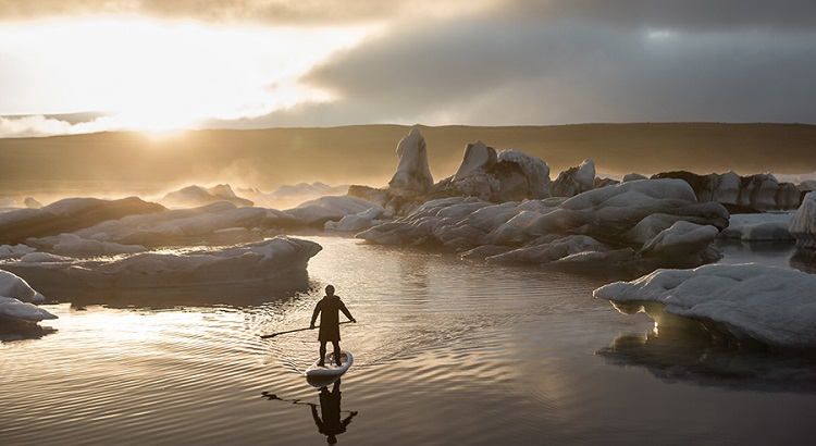 Getting up close and personal with Iceland's glacier lagoon on a paddleboard.