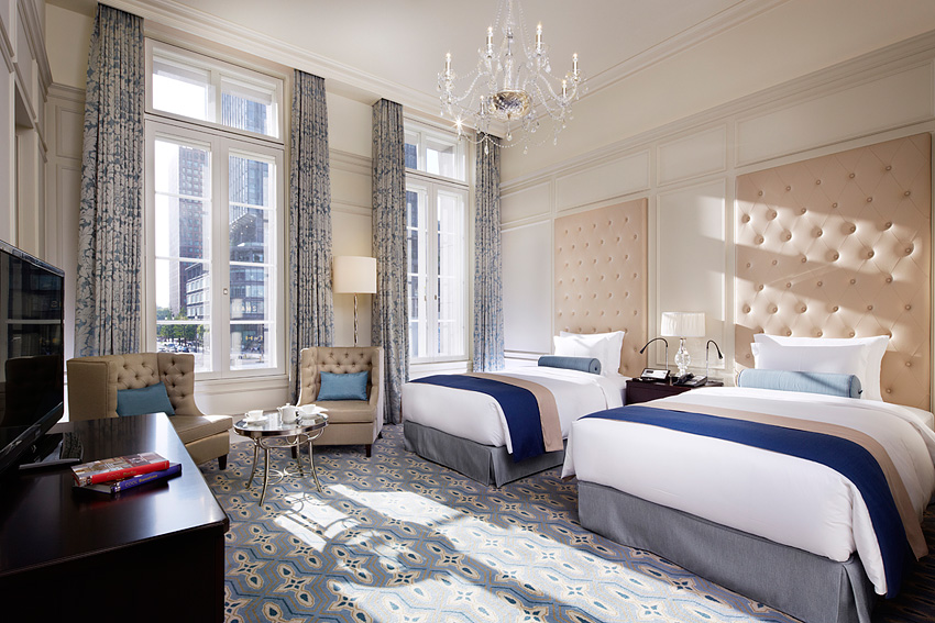 The guest  rooms feature feature cut-glass chandeliers and heavy silk drapery alongside big bathrooms outfitted with soaking tubs and high-tech toilets.