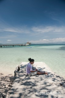 Jonathan Benitez working on a sketch of Honda Bay at Dos Palmas Island Resort, where he is artist-in-residence.