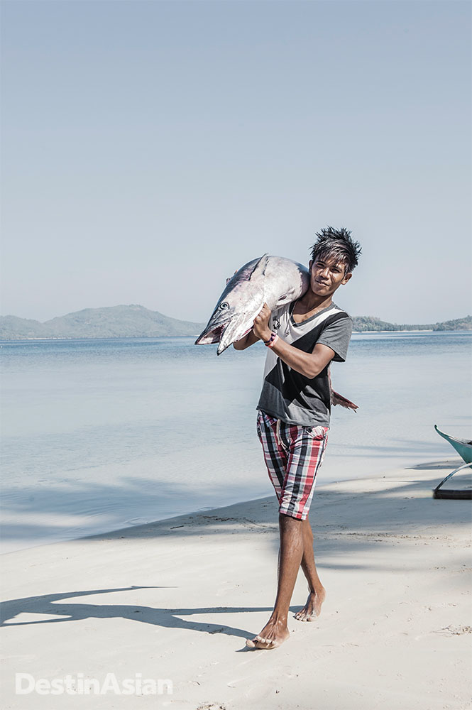 A freshly caught mackerel on its way to Tao's Kantina beach restaurant.