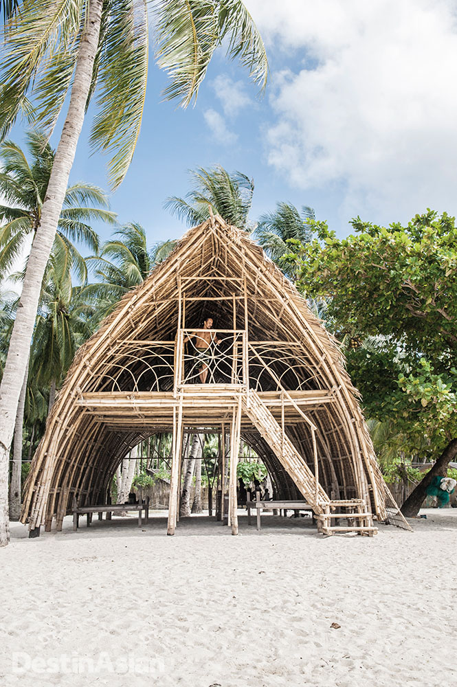A bamboo beach house at Tao Philippines' community-owned base camp and organic farm near San Fernando.