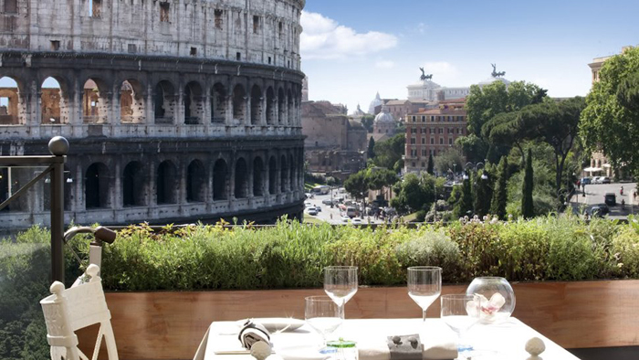 Having some meal at the terrace with Colosseum in the background.