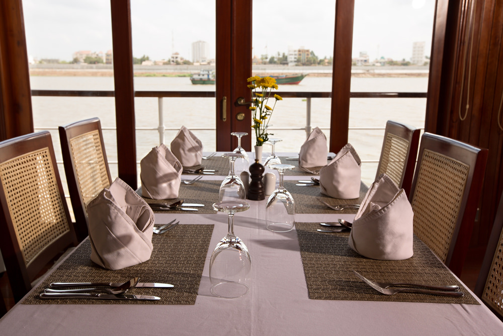 Enjoy fine dining aboard the 16-suite Angkor Pandaw boat.