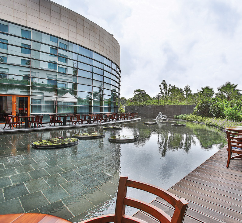 The Park Hyatt Chennai's semicircular rooftop infinity pool that overlooks Guindy National Park.