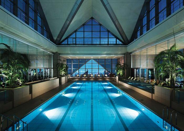Located on the top 14 floors of the Shinjuku Park Tower, the Park Hyatt Tokyo makes the most of its sky-high view, including a glass-roofed pool.