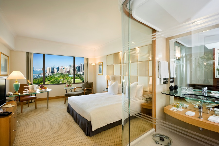 Rooms offer views of Victoria Harbour and Park.