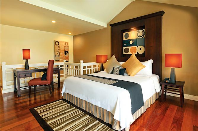 An upper-floor bedroom in the one-bedroom loft.