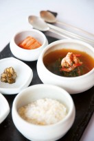 One of Roh's soups, featuring mallow, dried shrimp, and doenjang soybean paste.