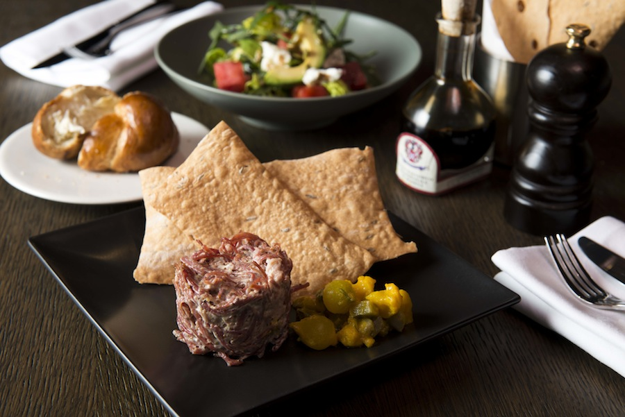 Bread Street's signature potted salt beef brisket is served with grain mustard, piccalilli, and caraway crackers.