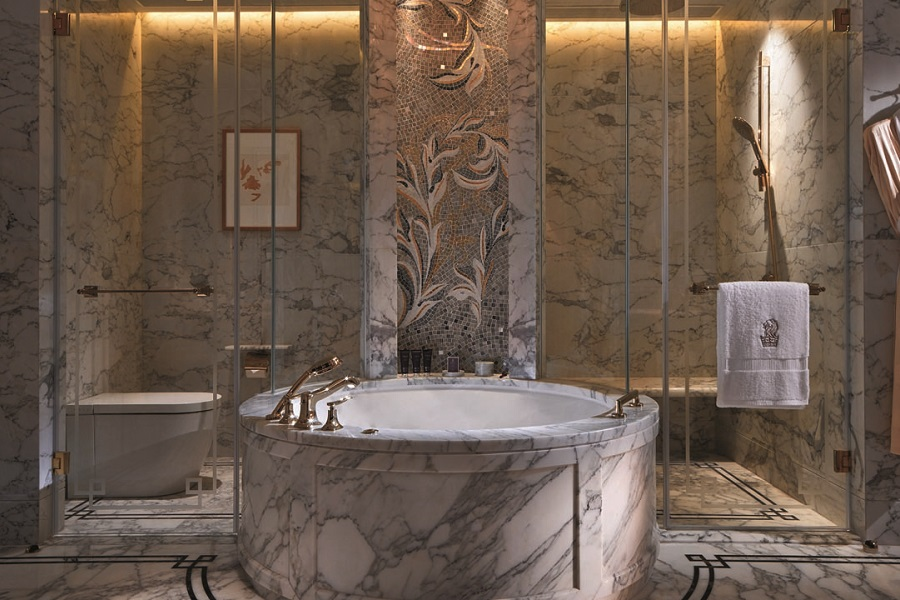 The Ritz-Carlton Macau suites feature a spacey and sumptuous bathroom with luxurious amenities.