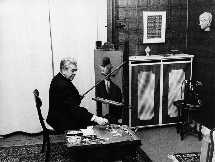 66-year-old Rene Magritte at work in his living room.