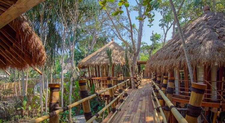 A bamboo bridge connects all three villas.