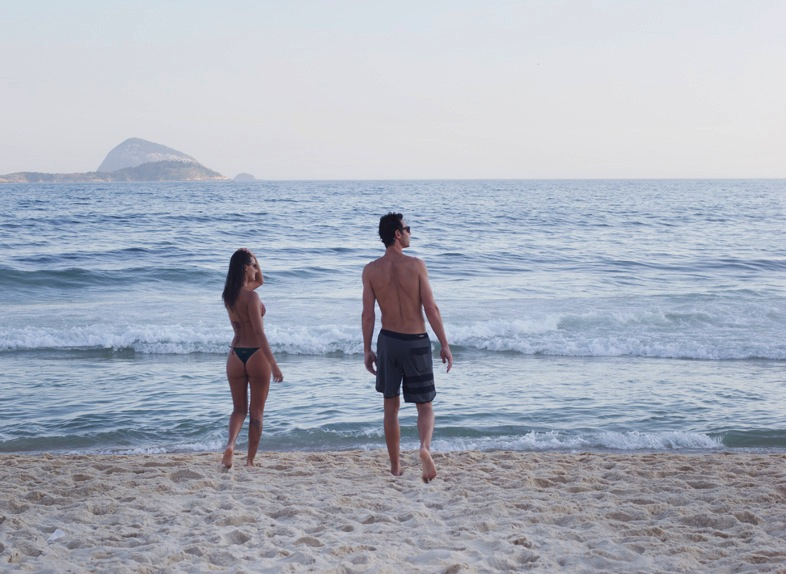 A couple on the beach in Ipanema.