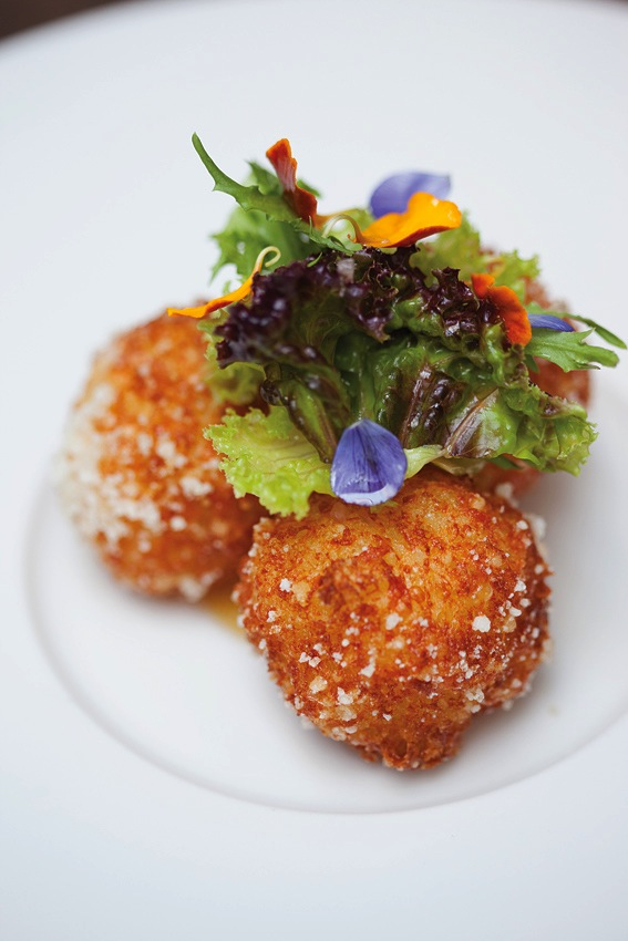 Irajá's crispy cheese-and-tapioca balls with apricot coulis.