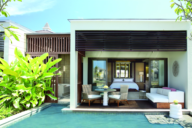The Pool Pavilions feature large balconies with daybeds and small dining tables.