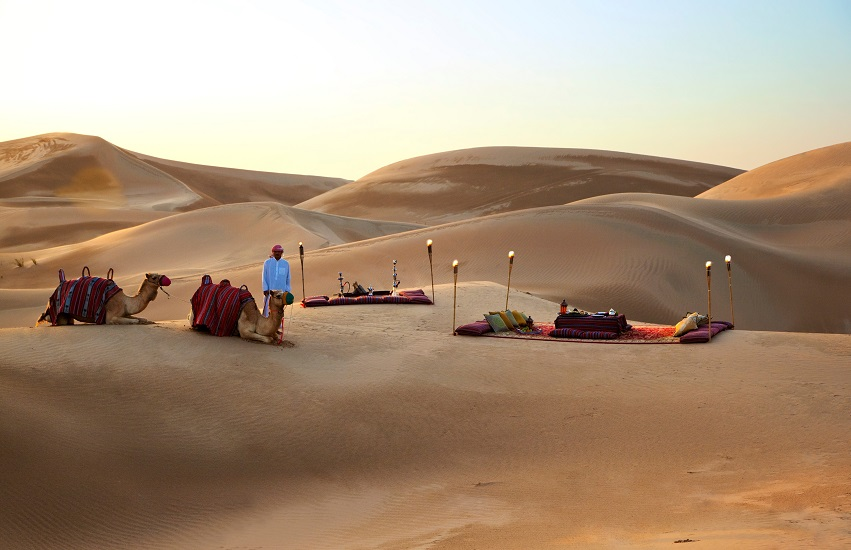 A sunset meal in the dunes surrounding Rosewood Abu Dhabi.