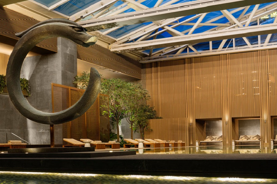 A work by the popular Chinese artist Liyongfei is displayed at the pool in Rosewood Beijing.