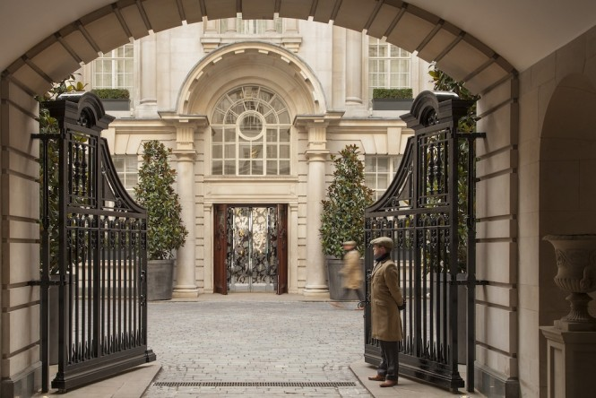 A wrought iron fence leads to the courtyard of the Rosewood.