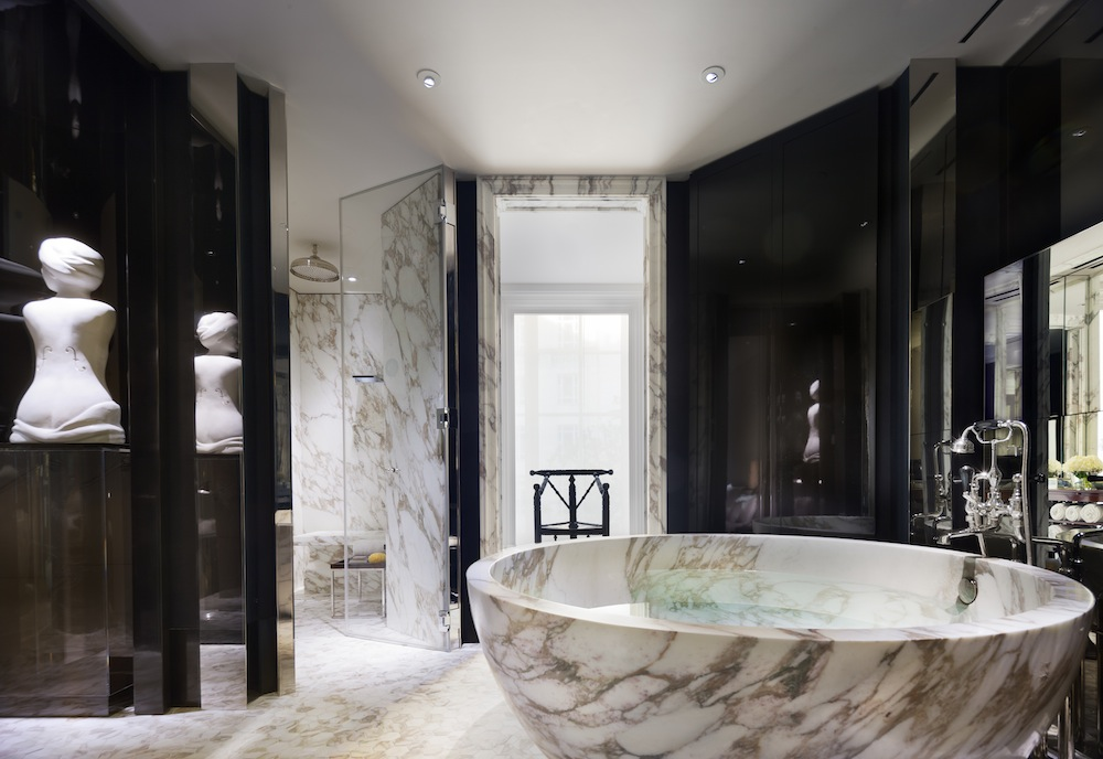 The opulent marble-clad bathrooms of the Manor House Suite.