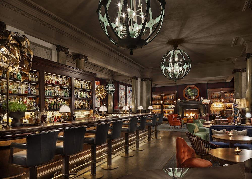 Gerald Scarfe's works adorn the wood-paneled walls of the eponymous bar.