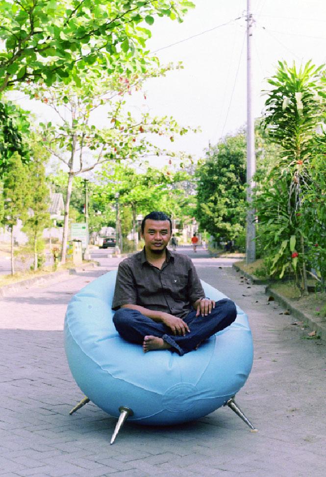 Rudi Mantofani on a chair of his own design outside his Yogyakarta studio.