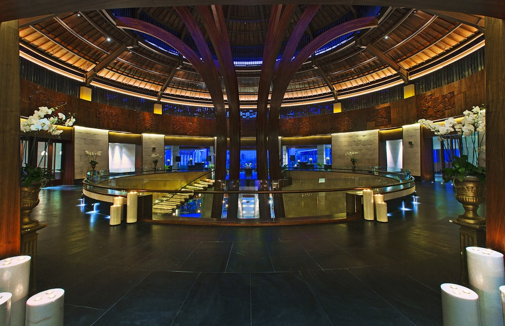 The banyan tree-inspired entry features a circle of life wood carving.