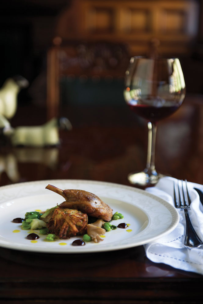 Pan-roasted breast and confit leg of duck with estate-grown vegetables and quince, in the dining room at Otahuna.