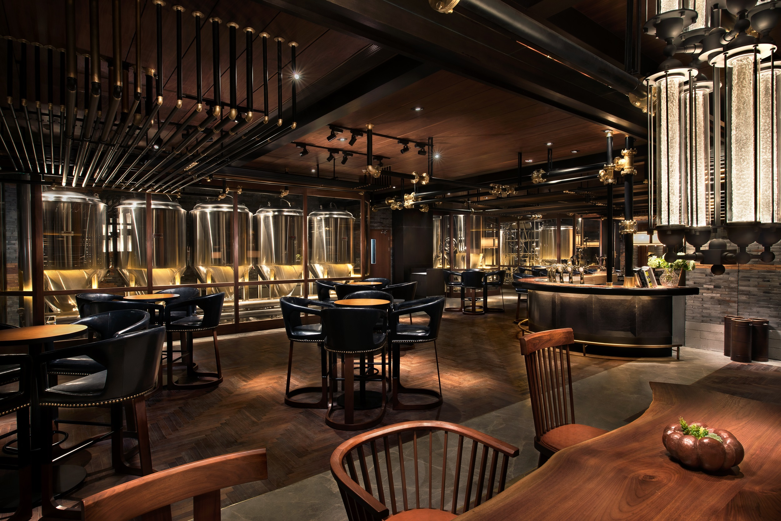 Tan leather and wood makes for a handsome bar design.