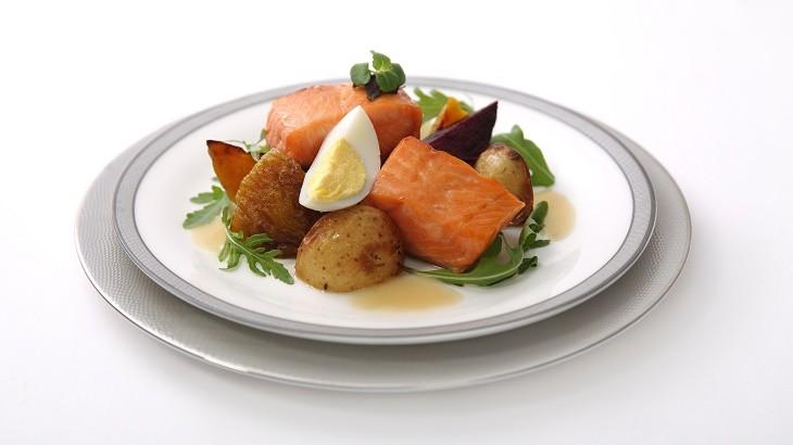 Baked herb-marinated salmon with potato, baked eggs, beets and arugula salad in dijon mustard vinaigrette.
