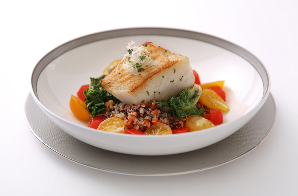 Chilean sea bass on a bed of kale and quinoa salad with tomato jelly and almond flakes