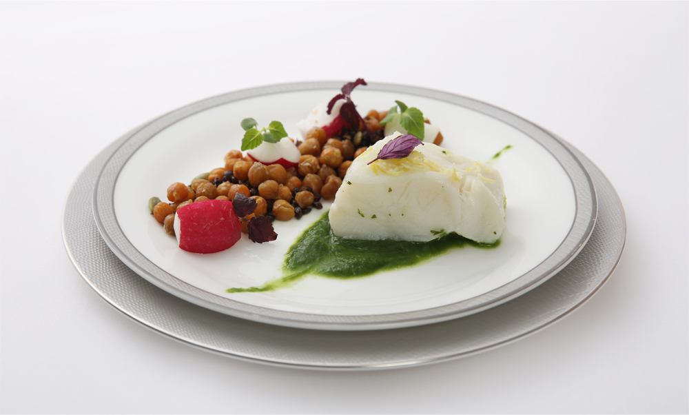 Citrus steamed sea bass with lettuce puree, legumes, radishes and sunflower seeds in citrus vinaigrette