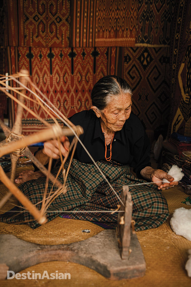 Spinning organic cotton thread in Sa'dan, a Torajan village known for its woven textiles.