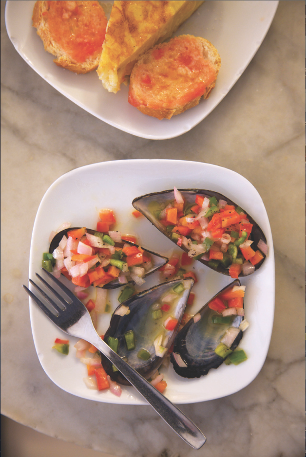 Tapas of mussels with marinated diced peppers at Bar del Pi in the Barri Gotic.