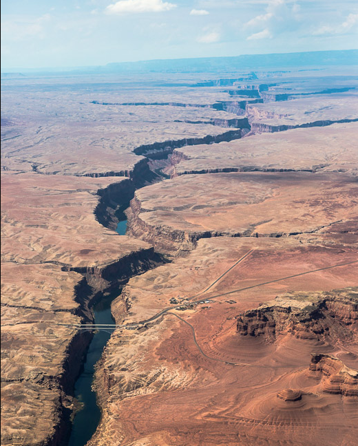 Looking over the Colorado Plateau near Lee's Ferry on the post-float flight back to Page, with 142-meter-high Navajo Bridge in the background.