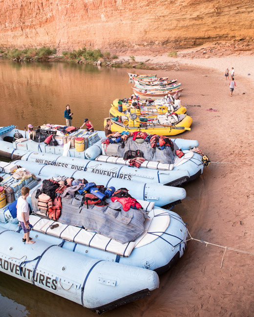 The rafts sharing a beach with other boats.