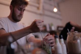 A bartender mixes drinks at hipster-hangout Seven.